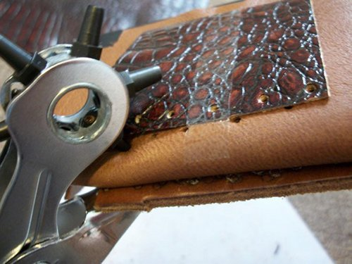 Rotary punch for stitching the card pockets.