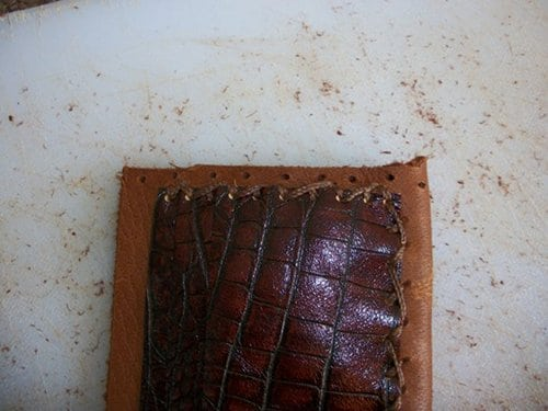 Threading the cowside of leather wallet.