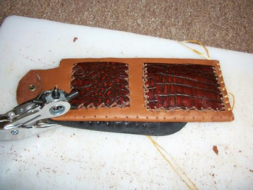 Using rotary punch for stitching the cowside of leather wallet.
