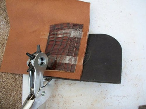 Using rotary punch for making leather wallet.