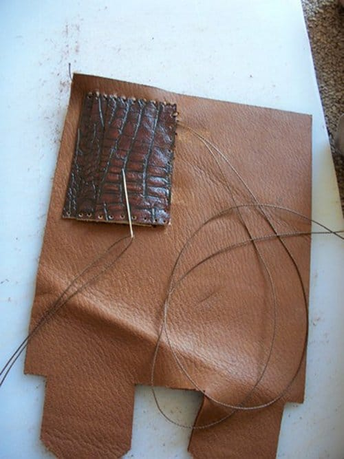 Sewing the card pocket for leather wallet.