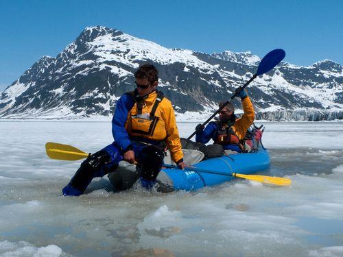 Andrew Skurka enjoying paddle rafting in ice river.