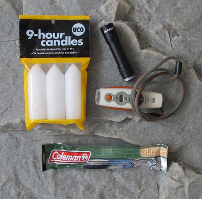 bug out bag supplies lighting candles flashlight