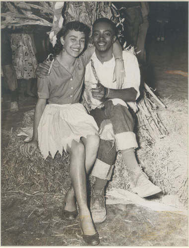 vintage black african american couple sitting on hay