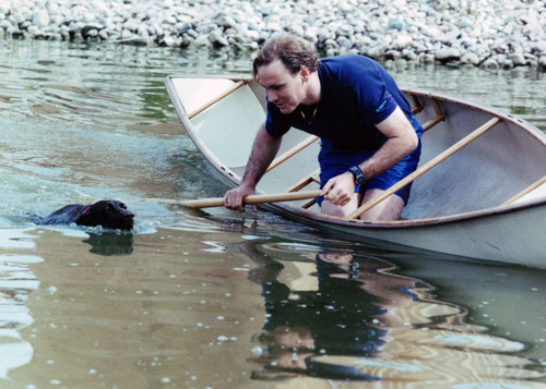 A drowning dog and a man in the boat.