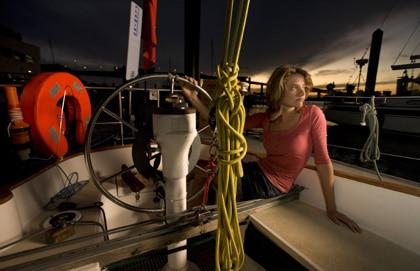 Jessica Watson sitting on sailboat.