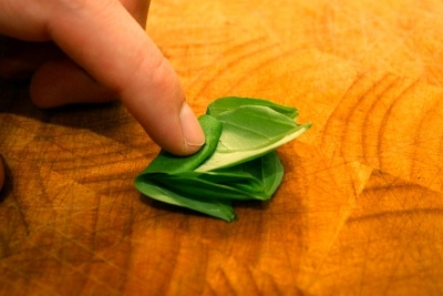 Man rolling the herbs leaves.