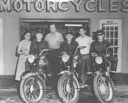 A group photo of riders sitting on motorcycles.