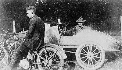 Charles Lindbergh enjoying the motorcycle race.