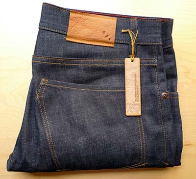 raw denim jeans folded with tag