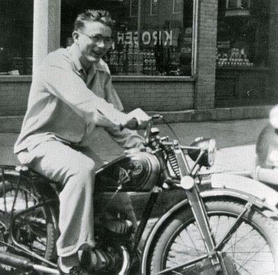 James Dean riding on motorcycle.