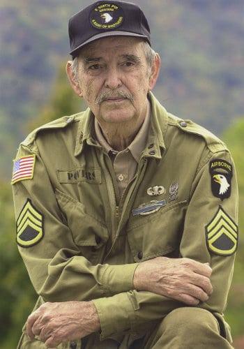Older man wearing military uniform.