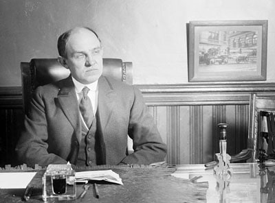vintage businessman sitting at desk starting sternly