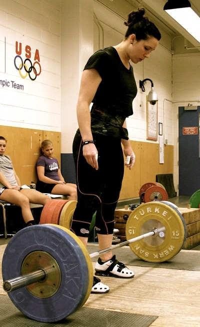 Natalie Burgener professional weightlifter barbell on ground.
