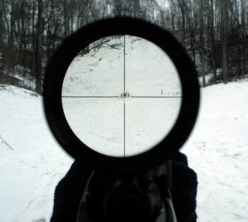 aiming shooting rifle with scope barrel view