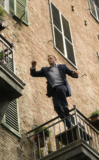 daniel craig james bond leaping from balcony