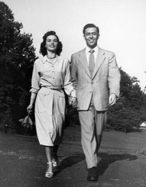 vintage man woman smiling walking holding hands