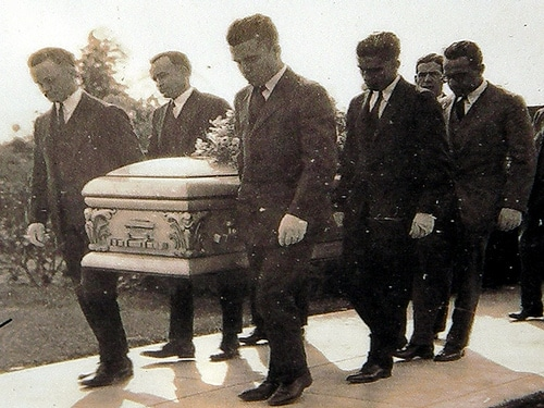 vintage funeral men pallbearers carrying casket