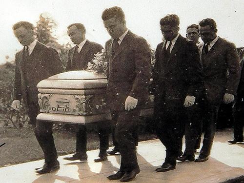 Men carrying casket for funeral.