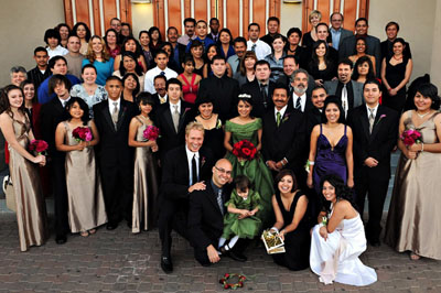 A group photo of Latino Mexican quinceanera.