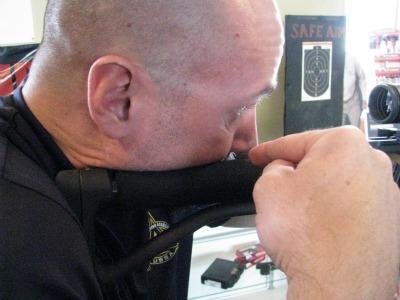 Man proper cheeking the shooting point of rifle.