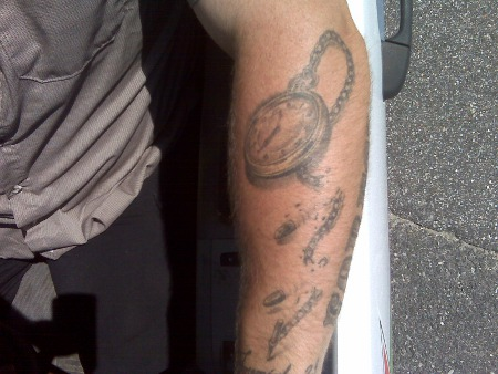 tattoo on arm pocket watch chain broken