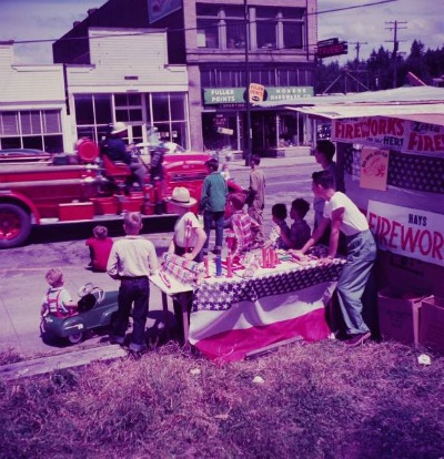 vintage fireworks stand next to parade route 1960s 1970s
