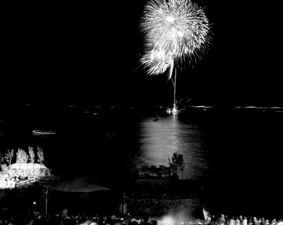 fireworks show over water lake black white photo