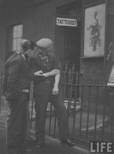 vintage life magazine men outside tattoo shop