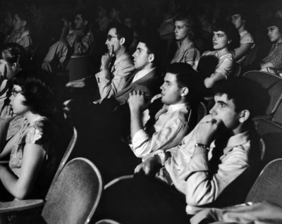 vintage movie theater patrons sitting in chair