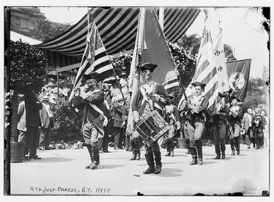 vintage 4th of july parade men dress as revolutionaries