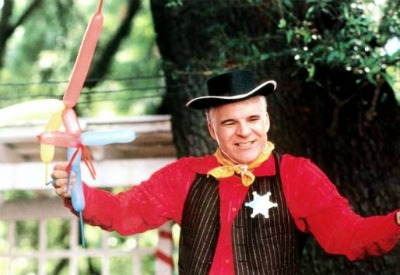 Parenthood movie Steve Martin dressed up and holding balloons.
