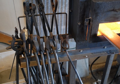 blacksmith blacksmithing tongs for holding hot steel metal