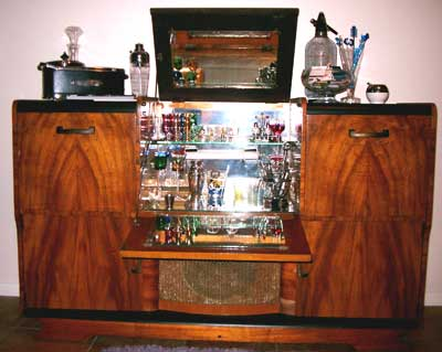A man with enough initiative can probably make his own cocktail cabinet.  Imagine the pride you'll feel when you can pat your mini bar, hand your  friend a ... - How To Stock A Home Bar The Art Of Manliness