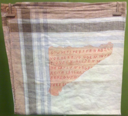 An encoded message written on a handkerchief.