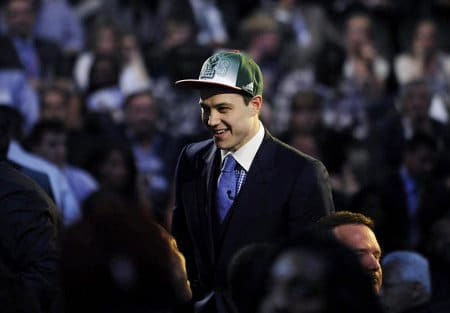 jimmer fredette draft night sacramento kings hat smiling
