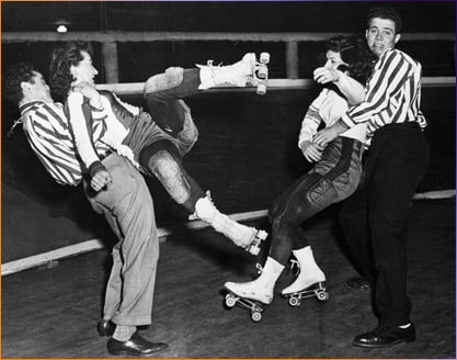 Vintage couples cheering on a roller in derby duke club.
