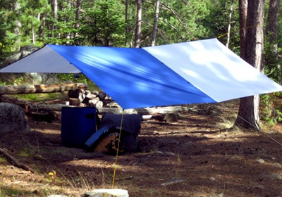Tarp tent pitch camping shelter protection from elements.