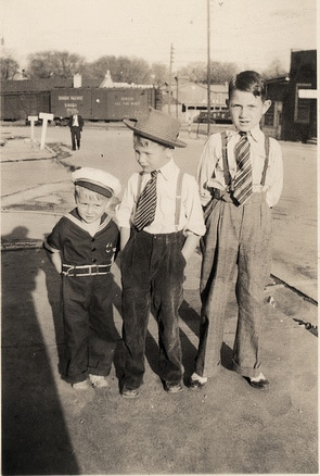 vintage three young boys dressed nice standing in line