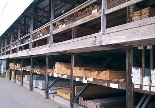 lumber yard shelves filled with board wood