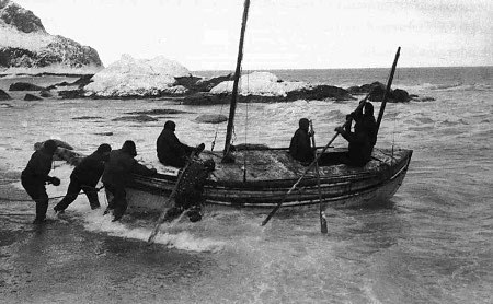 shackleton expedition men launching boat from shore