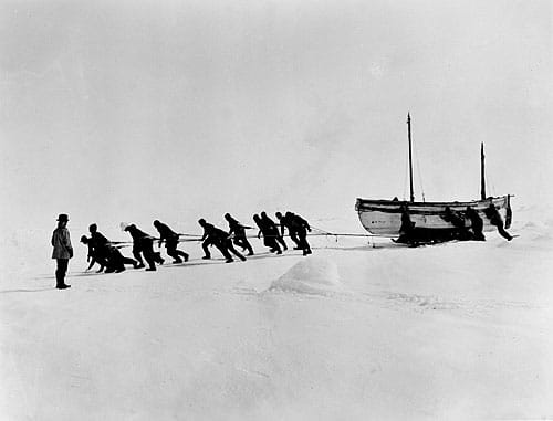 shackleton expedition men pulling boats across ice