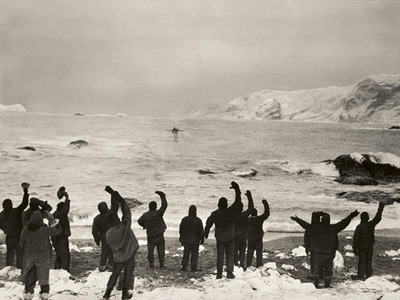Shackleton expedition men waving from shore to the boat.
