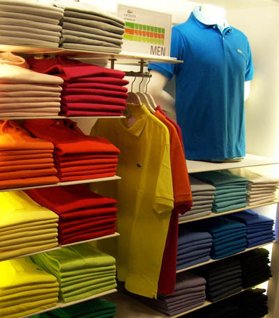 Colorful polo shirt on shelves.