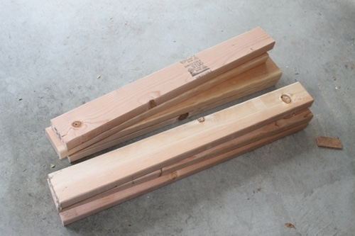 pile of cut wood 2x4 for diy homemade sawhorse