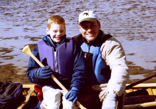 A father with son in a boat.