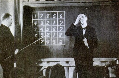 vintage man in classroom memorizing numbers blackboard