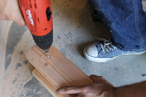 Making holes for a screw in a wood.