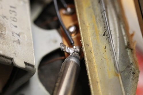 Soldering a wire.