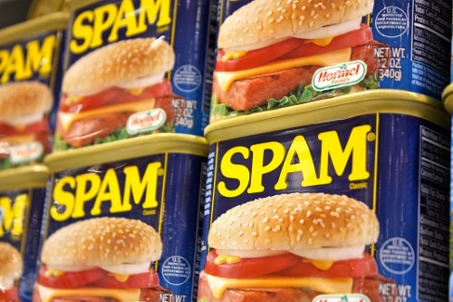 cans of spam on grocery store shelf close up photo